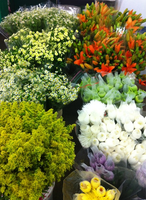 early morning starts at the flower mart.