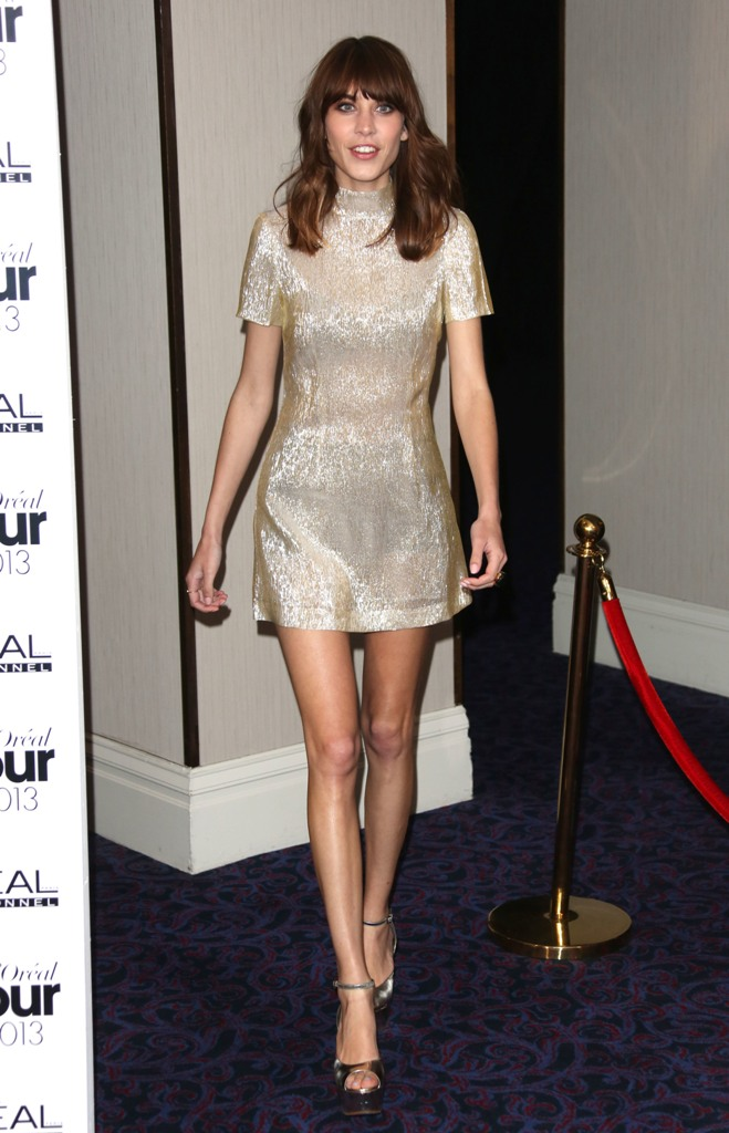 Alexa Chung in a mini gold metallic dress.