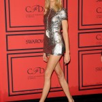 Karolina Kurkova in golden shorts and top. Golden legs optional.