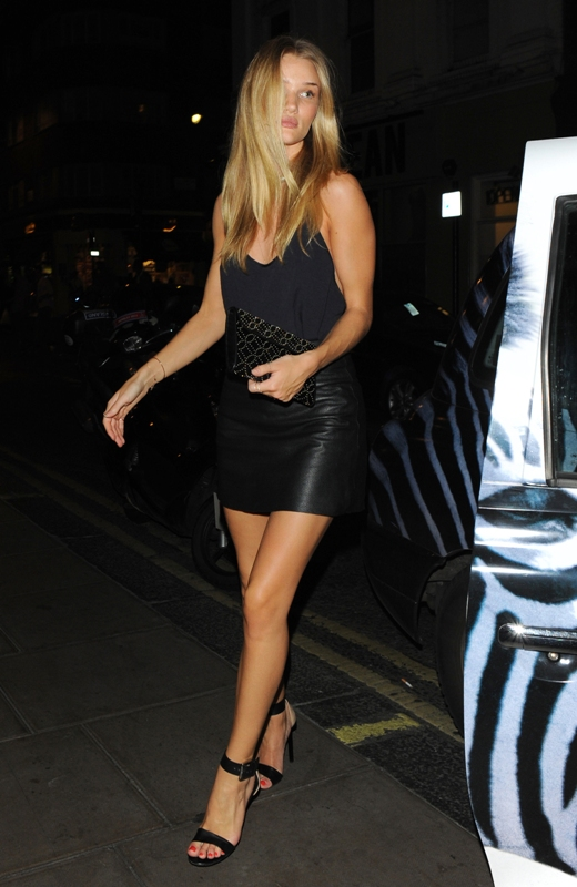 An unimpressed Rosie Huntington-Whiteley nearly had her toes trodden on by a paparazzo as she arrives at The Groucho Club. Luckily for the photographer, Rosie's hard man boyfriend Jason Statham did not see the incident as he followed her into the club Featuring: Rosie Huntington-Whiteley Where: London, United Kingdom When: 16 Aug 2013 Credit: WENN.com