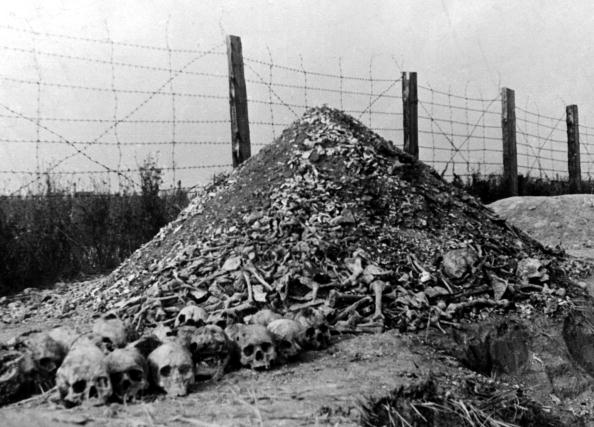 A pile of human bones and skulls is seen in 1944 a