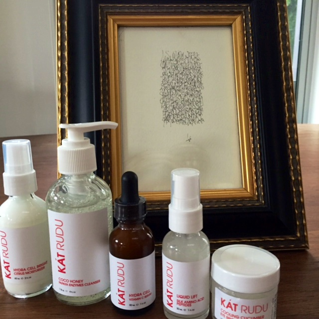 Kat Rudu Beauty Collection -- image of bottles in front of framed picture