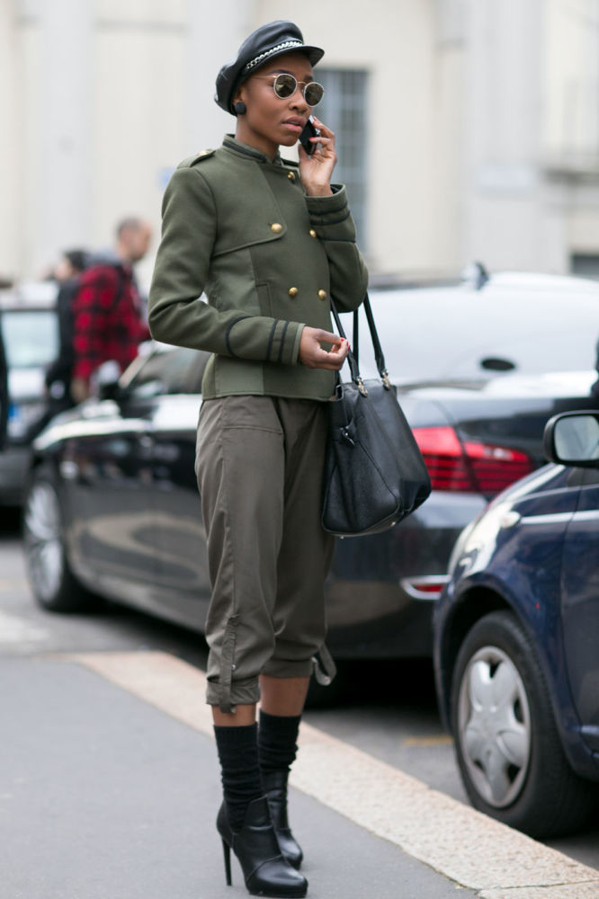 woman in olive green jacket and pants and black leather stilettos