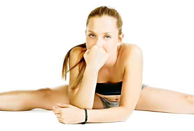 girl doing yoga and looking upset