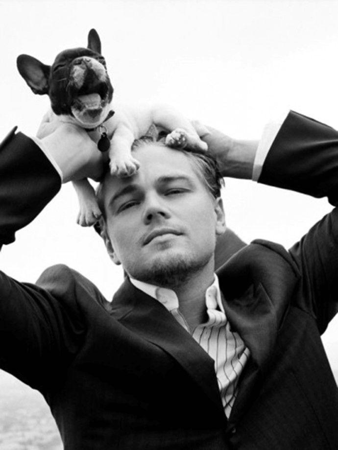 leonardo dicaprio posing with a puppy