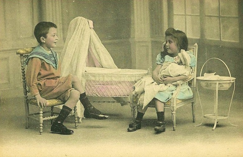 old photo of boy and girl playing house