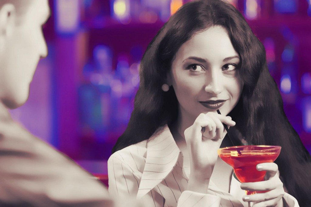 Young couple in bar having drinks and talking 2
