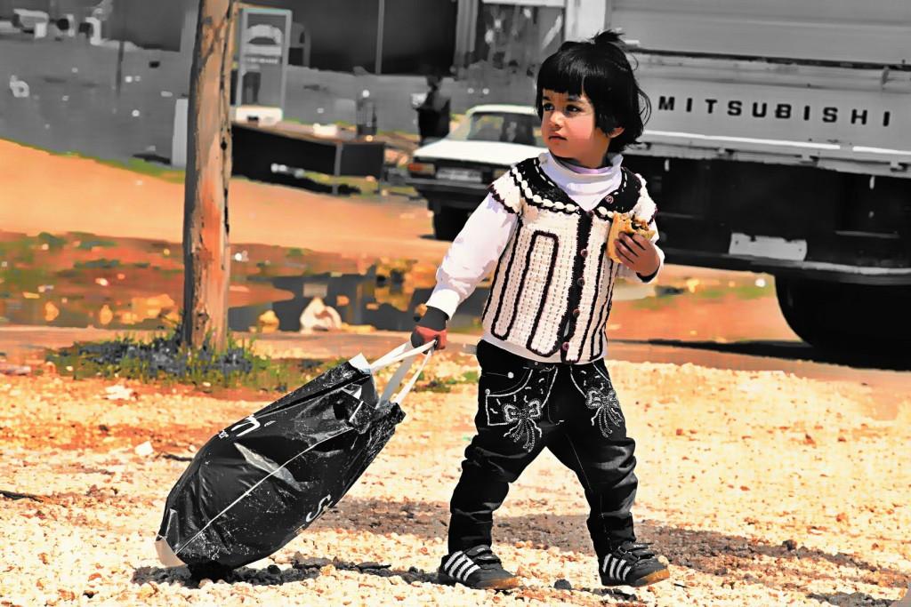 child returning into Kobane. 3.4.2015, Kobane, Syria