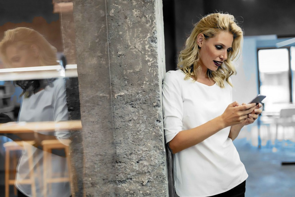 blonde woman texting on cell phone 2