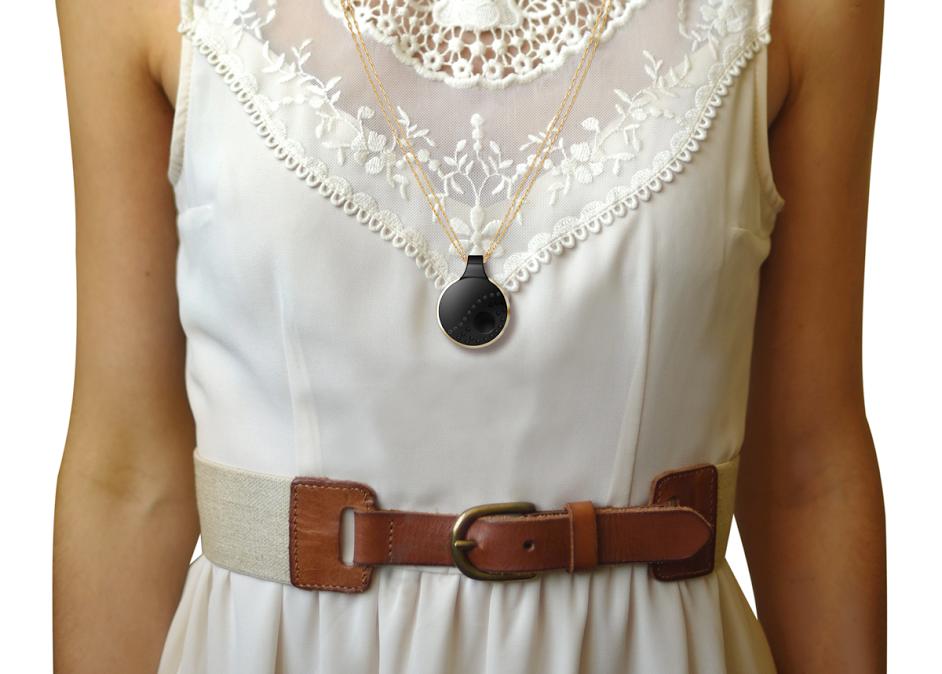 half-shot of model wearing athena pendant around her neck