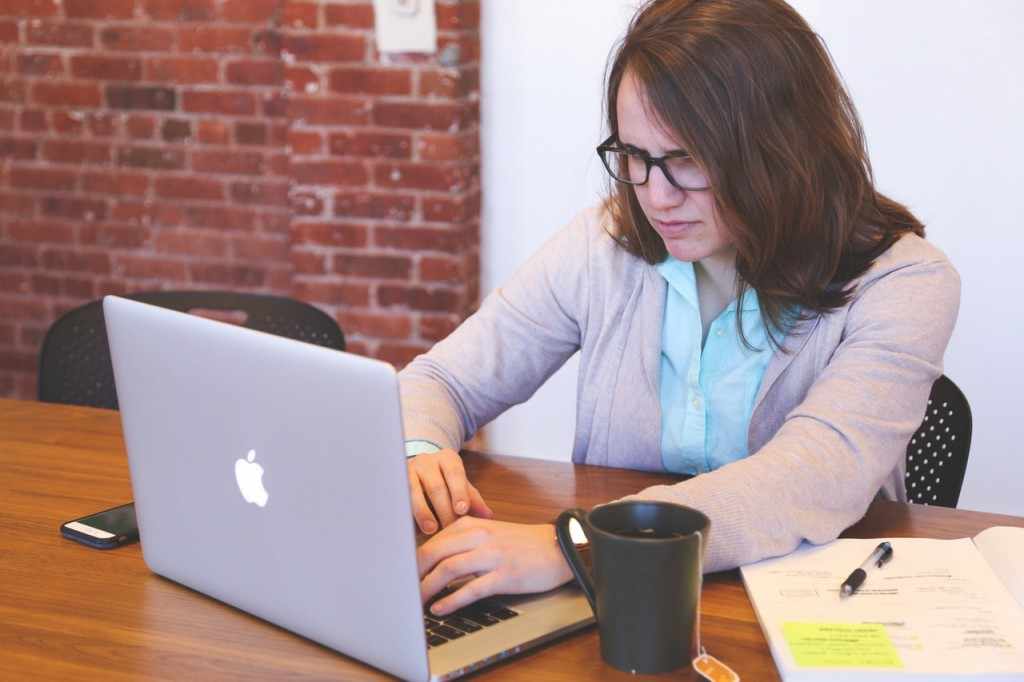 women angrily answering emails