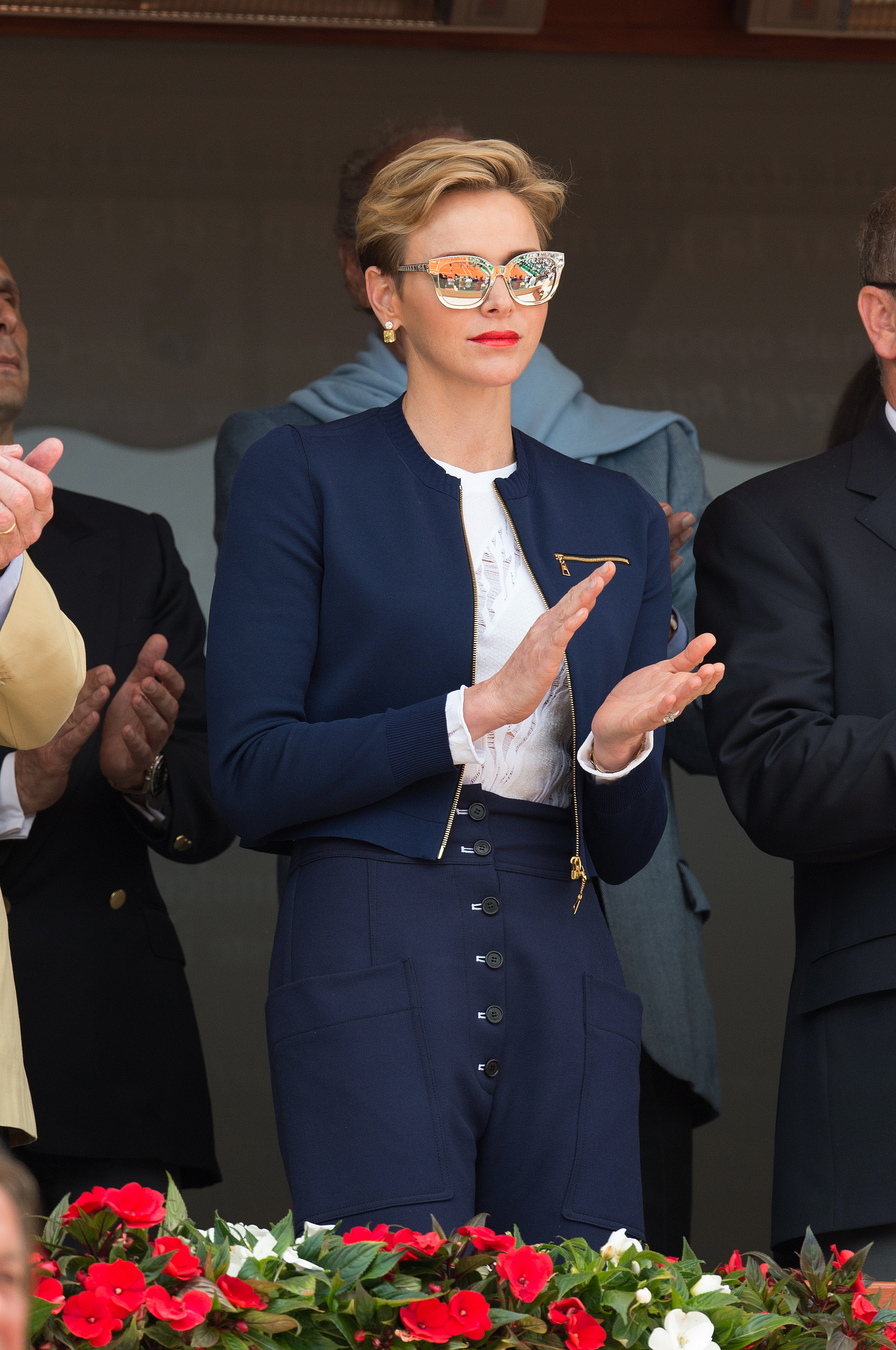 Princess Charlene of Monaco being a little on the nose with her choice of royal blue pantsuit.