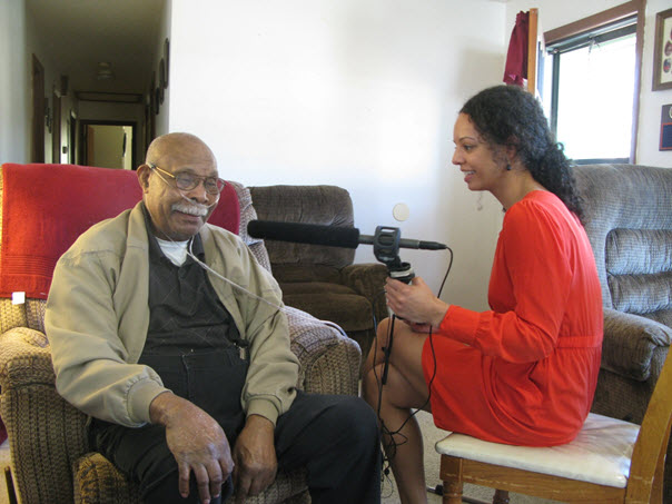 Dickerson speaking with veteran Charles William for her series on mustard gas testing during WWII