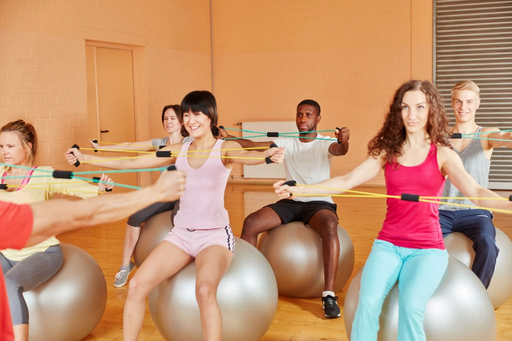 57362706 - group stretching with bands and training at the gym