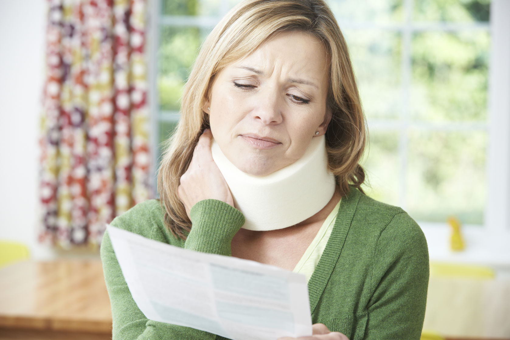 47816524 - woman reading letter after receiving neck injury