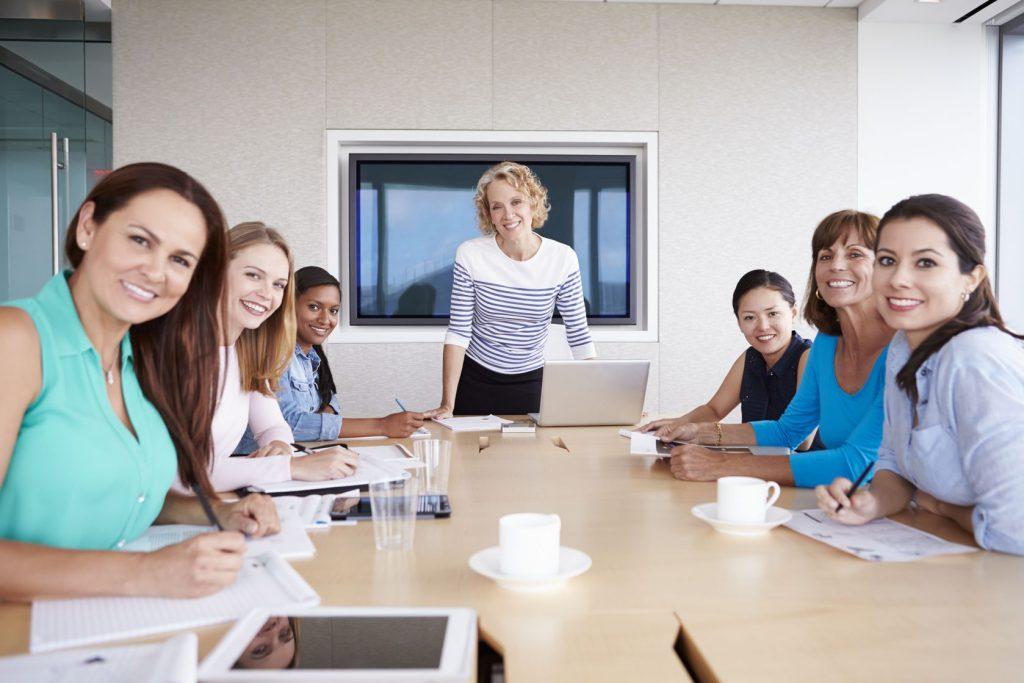 42314925 - group of businesswomen meeting around boardroom table