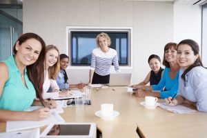 42314925 - group of businesswomen meeting around boardroom table