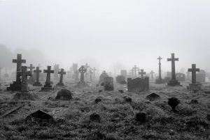 22882869 - spooky foggy ancient cemetery halloween background