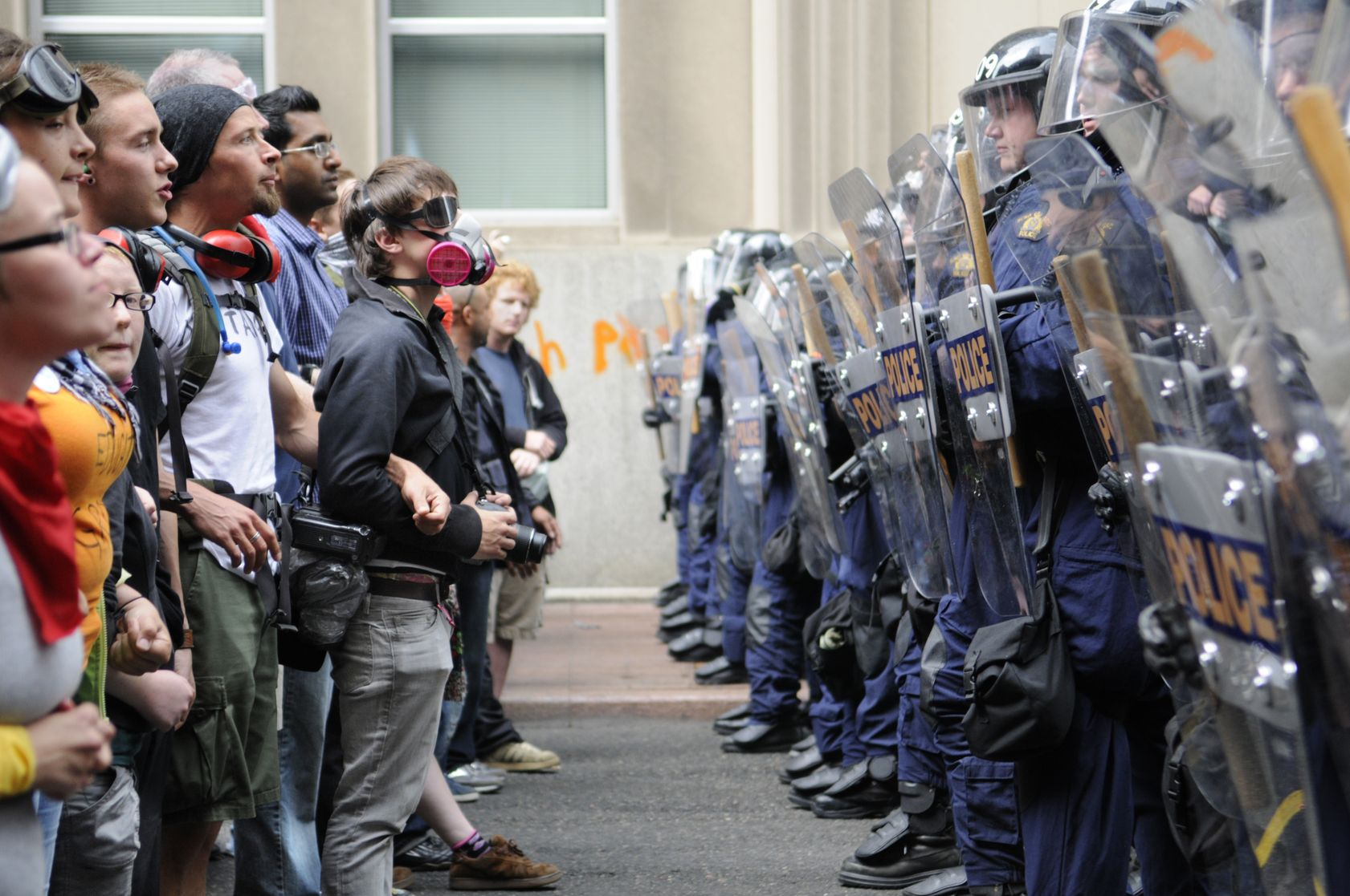 20263987 - toronto-june 26: toronto riot police (r) restrict protesters from entering g20 summit area at the metro convention centre on june 26, 2010 in toronto, canada.