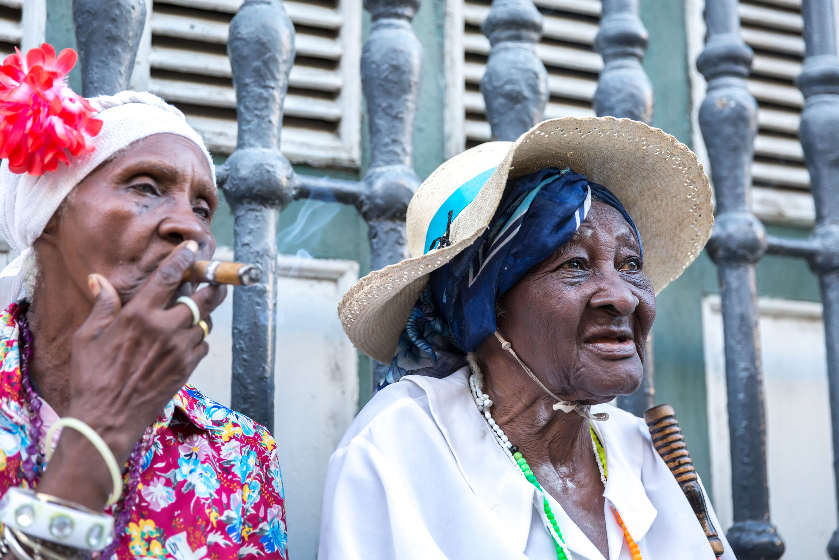 52445017 - portrait of african cuban woman smoking cigar in havana, cuba